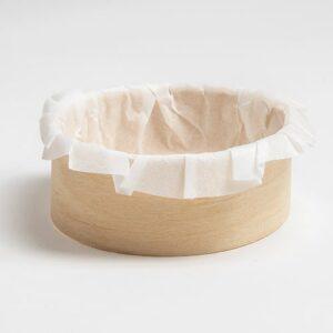Barquette cuisson en bois ronde de taille 80xh30 mm avec son papier sulfurisé blanc